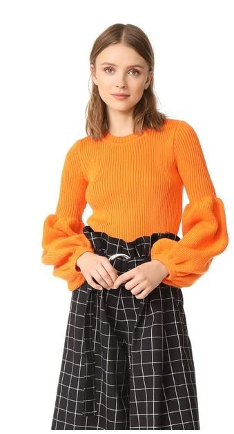 Ksenia-Schnaider-Orange-Puff-sleeve-sweater